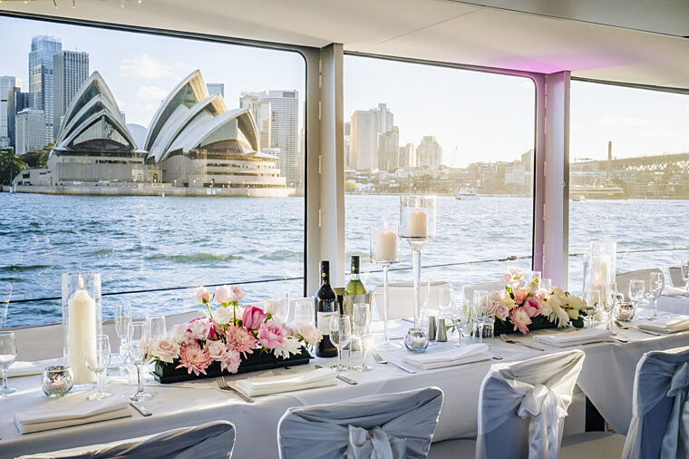 Captain Cook 3 wedding charter dining set up with Opera House in the background