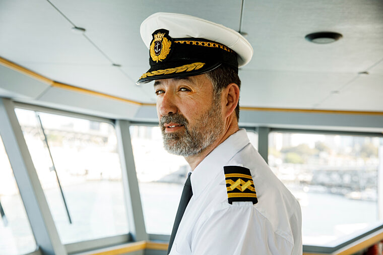 Senior captain crew driving boat