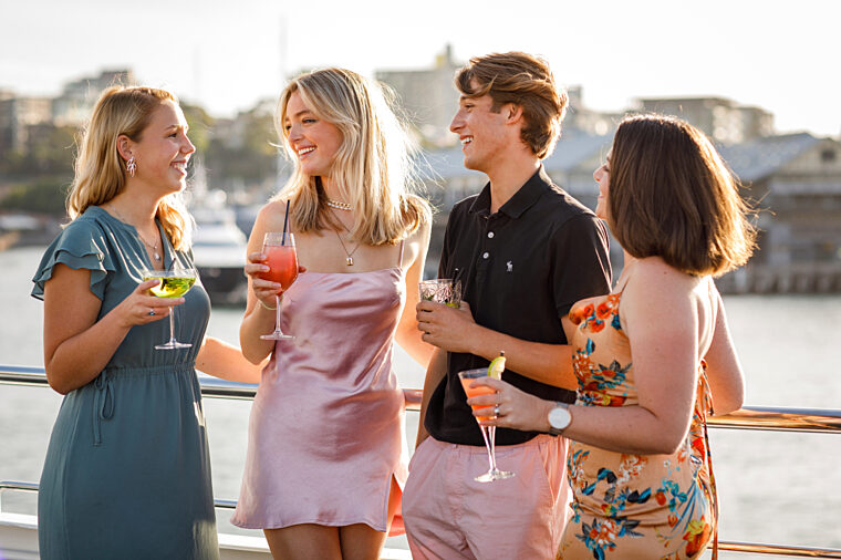 Group of young friends having casual cocktail drinks outdoor