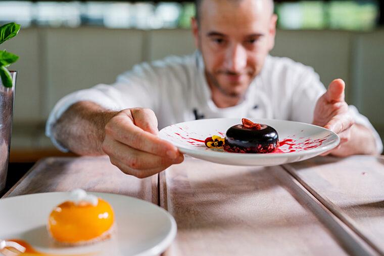 Chef preparing dessert plate food for dining dinner lunch premium