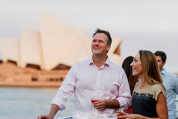 Senior couple enjoying harbour views premium sightseeing with Opera House in the background