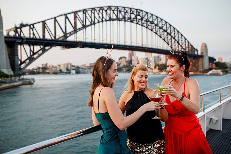 Smart casual group of charter girls celebrating Christmas special events with Harbour Bridge in the background