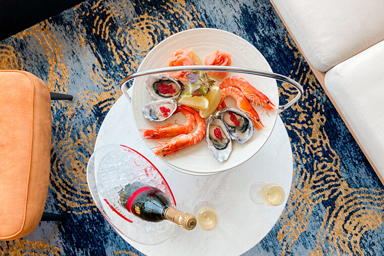 Mumm Harbour Bar champagne and prawns from above food tiered plate and bottle casual dining