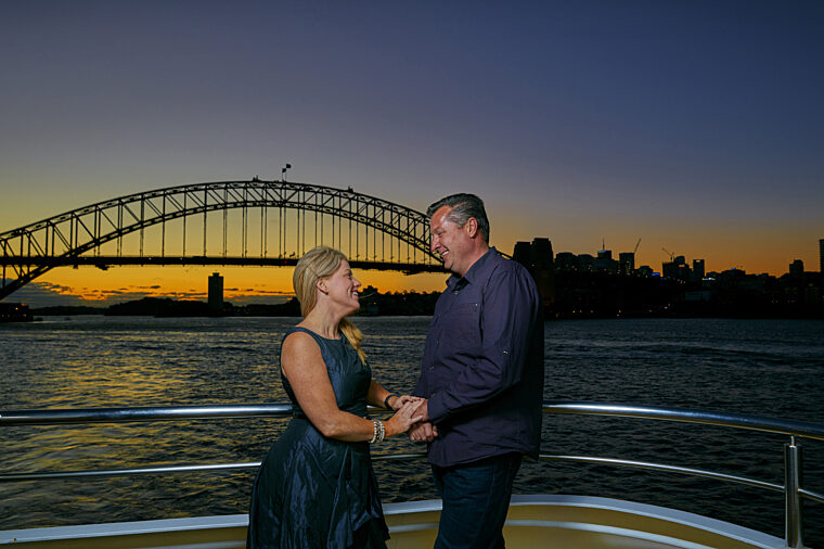 Couple valentines onboard Club Deck with sunset in the background with Harbour Bridge special occasion anniversary