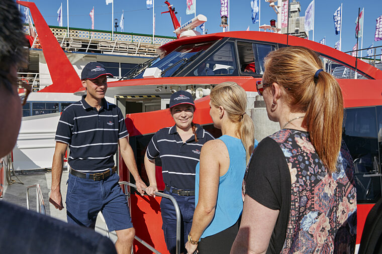 Rocket ferry commuters and crew interacting close up at Pier 26 Hop On Hop Off sightseeing
