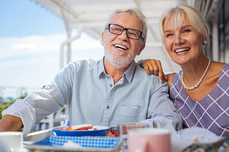 Senior couple having casual dining lunch and smiling non-ccc stock