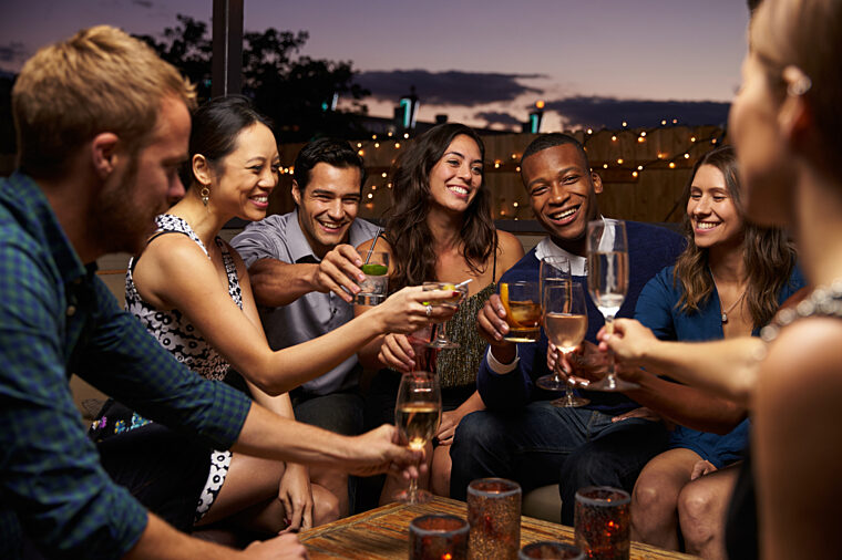 Groups of friends having drinks at night casual bar