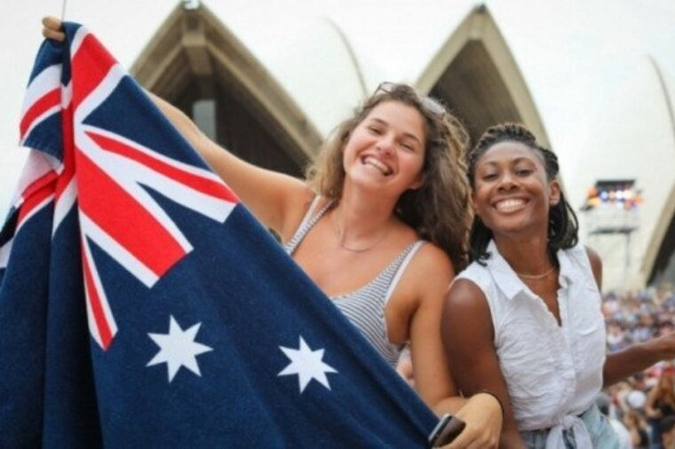 Two women holding flags to celebrate australia day at opera house special event non-ccc dnsw